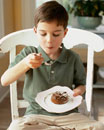 Boy eating chocolate souffle