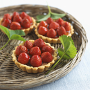 Strawberry tartlets on a wicker tray
