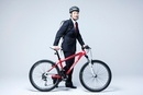 Young Businessman With Bicycle