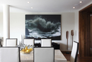 Dining area with large seascape artwork on rear wall in UK show home