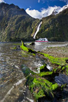Bowen Falls with cruise vessel passing,Milford Sound,Fjord