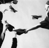 G.B. ENGLAND. London. Mortar Boards in the air photographed for an advertisement for