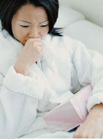 Sick Woman Holding Tissues