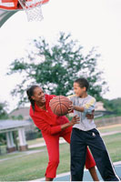 Mother and Son Playing Basketball