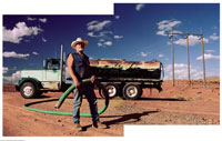 Oil Worker with Tanker and Hose 20025146505| 写真素材・ストックフォト・画像・イラスト素材|アマナイメージズ