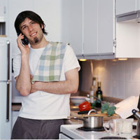 Man Using Telephone in Kitchen