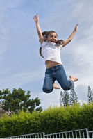 Girl Jumping on Trampoline