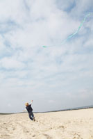 Boy Flying Kite at Beach