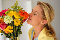 Woman Smelling Flower Bouquet