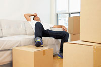 Man Resting on Couch After Moving