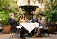 Business executives having lunch in a hotel,Biltmore Hotel