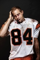 Portrait of Dirty, Bleeding Football Player