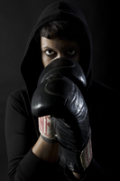 Woman Wearing Boxing Gloves and Hoodie