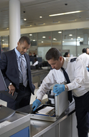 Security Guard Checking Businessman's Briefcase at Airport 20025311661| 写真素材・ストックフォト・画像・イラスト素材|アマナイメージズ