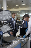 Security Guard Checking Businessman's Briefcase in Airport 20025311662| 写真素材・ストックフォト・画像・イラスト素材|アマナイメージズ