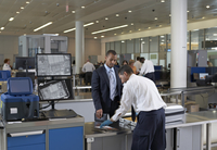 Security Guard Checking Businessman's Luggage in Airport 20025311663| 写真素材・ストックフォト・画像・イラスト素材|アマナイメージズ