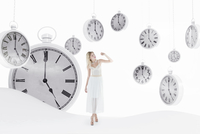 Young woman wearing white dress, standing in abstract landscape with pocket watches hanging in sky, studio shot 20025318994| 写真素材・ストックフォト・画像・イラスト素材|アマナイメージズ