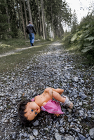Austria, Linz, stripped doll lying on forest track while man going away 20025330832| 写真素材・ストックフォト・画像・イラスト素材|アマナイメージズ