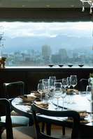 Place settings at circular dining table with view of downtown 20025340719| 写真素材・ストックフォト・画像・イラスト素材|アマナイメージズ