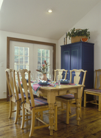 DINING AREA - Pine table, chairs, dark blue tall cabinet, wood floors, double doors, plaid cushions, country style, set for dinn 20025340854| 写真素材・ストックフォト・画像・イラスト素材|アマナイメージズ