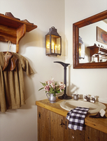 BATHROOMS: Sink in rustic  wood vanity, antique lantern as wall sconce, wood mirror, wood shelf, antique childs shirt and wooden 20025340873| 写真素材・ストックフォト・画像・イラスト素材|アマナイメージズ