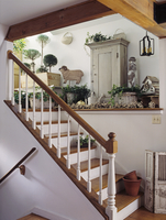 STAIRWAYS: Natural, fresh llok, topiaries fill weathered garden containers, architectural salvage, porch posts, birdhouse a nd w 20025340876| 写真素材・ストックフォト・画像・イラスト素材|アマナイメージズ