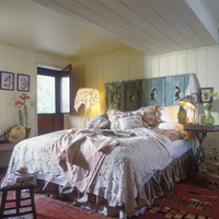 BEDROOMS - Attic bedroom, wood ceiling, unique wooden screen used as headboard, vintage bedding, crocheted bedspread, dutch door 20025340883| 写真素材・ストックフォト・画像・イラスト素材|アマナイメージズ