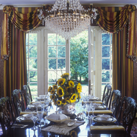 DINING ROOM: looking toward open French doors, striped curtains and swags with rosettes and fringe, sunflower arrangement, forma 20025340903| 写真素材・ストックフォト・画像・イラスト素材|アマナイメージズ