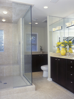 BATHROOMS: Overall large square ceramic tile floor and shower stall, glass walls on stall, coffee colored wood cabinets, part of 20025340961| 写真素材・ストックフォト・画像・イラスト素材|アマナイメージズ
