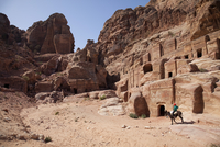 Child riding a donkey in front of cave dwellings in Petra, UNESCO World Heritage Site, Jordan, Middle East 20025369900| 写真素材・ストックフォト・画像・イラスト素材|アマナイメージズ