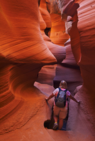 Female tourist hiker and Sandstone Rock formations, Lower Antelope Canyon, Page, Arizona, United States of America, North Americ 20025374973| 写真素材・ストックフォト・画像・イラスト素材|アマナイメージズ