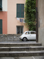 Typical Tuscan Street with Laundry on Clothesline and Fiat Car, Tuscany, Italy
