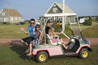 Family in Golf Cart