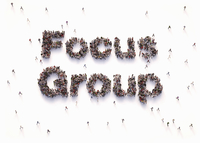 "Overhead view of people forming words ""focus group"" 20039010621