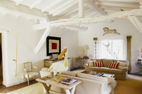Living room with a sofa suite in a converted attic and white 20052011473| 写真素材・ストックフォト・画像・イラスト素材|アマナイメージズ