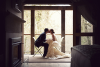 bride and groom share a quiet moment and kiss 20055017925| 写真素材・ストックフォト・画像・イラスト素材|アマナイメージズ