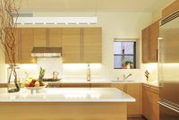 Sleek Kitchen With White Stone Island And Tan-Colored Cabinets 20055022305| 写真素材・ストックフォト・画像・イラスト素材|アマナイメージズ
