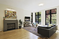 Living Room With Slate Fireplace, Leather Couch, View Onto City Street 20055022306| 写真素材・ストックフォト・画像・イラスト素材|アマナイメージズ