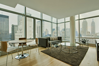 Modern Styled Living Room With Floor To Ceiling Windows And Panoramic City Views 20055022313| 写真素材・ストックフォト・画像・イラスト素材|アマナイメージズ