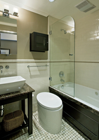 Bathroom With Cylindrical Toilet And Dark Marble Trimmed Fixtures 20055022330| 写真素材・ストックフォト・画像・イラスト素材|アマナイメージズ