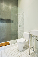 New Bathroom With Green Tiled Shower Stall And White Tiled Floor 20055022341| 写真素材・ストックフォト・画像・イラスト素材|アマナイメージズ