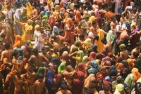 Colorful crowd of people celebrate the Holi Festival, India