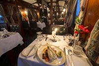 Dinner in the galleried wood panelled Edwardian vintage dining coach, Rovos Rail, South Africa, Africa 20062022170| 写真素材・ストックフォト・画像・イラスト素材|アマナイメージズ