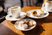 Turkish delights (Lokum) on plate and coffee, Cafe near Spice Bazaar, Istanbul, Turkey, Europe