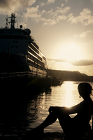 Silhouette of female and cruise ship