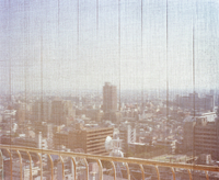 View of Osaka skyline, Japan. Shot through a hotel blind with buildings in distance. 20071006366| 写真素材・ストックフォト・画像・イラスト素材|アマナイメージズ