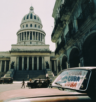 "Capitol Building with classic red fifties car in foreground and ""Cuba,Cuba,Cuba""  sun-shield in foreground. Havana  20071006528