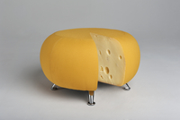 Round yellow padded stool with short chrome legs similar to round of cheese revealing cheese inside 20071009130| 写真素材・ストックフォト・画像・イラスト素材|アマナイメージズ