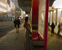 Redheaded woman reads a timetable at Vauxhall bus station, South London, United Kingdom 20071009429| 写真素材・ストックフォト・画像・イラスト素材|アマナイメージズ