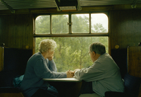 Older couple hold hands and look out the window of a train in rural countryside. Gloucestershire, England, United Kingdom 20071010907| 写真素材・ストックフォト・画像・イラスト素材|アマナイメージズ